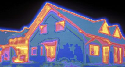 COMPUTER-COLOR CODED INFRARED THERMOGRAPHY OF HOUSE. BRIGHTER COLORS REPRESENT AREAS OF HEAT LOSSES.